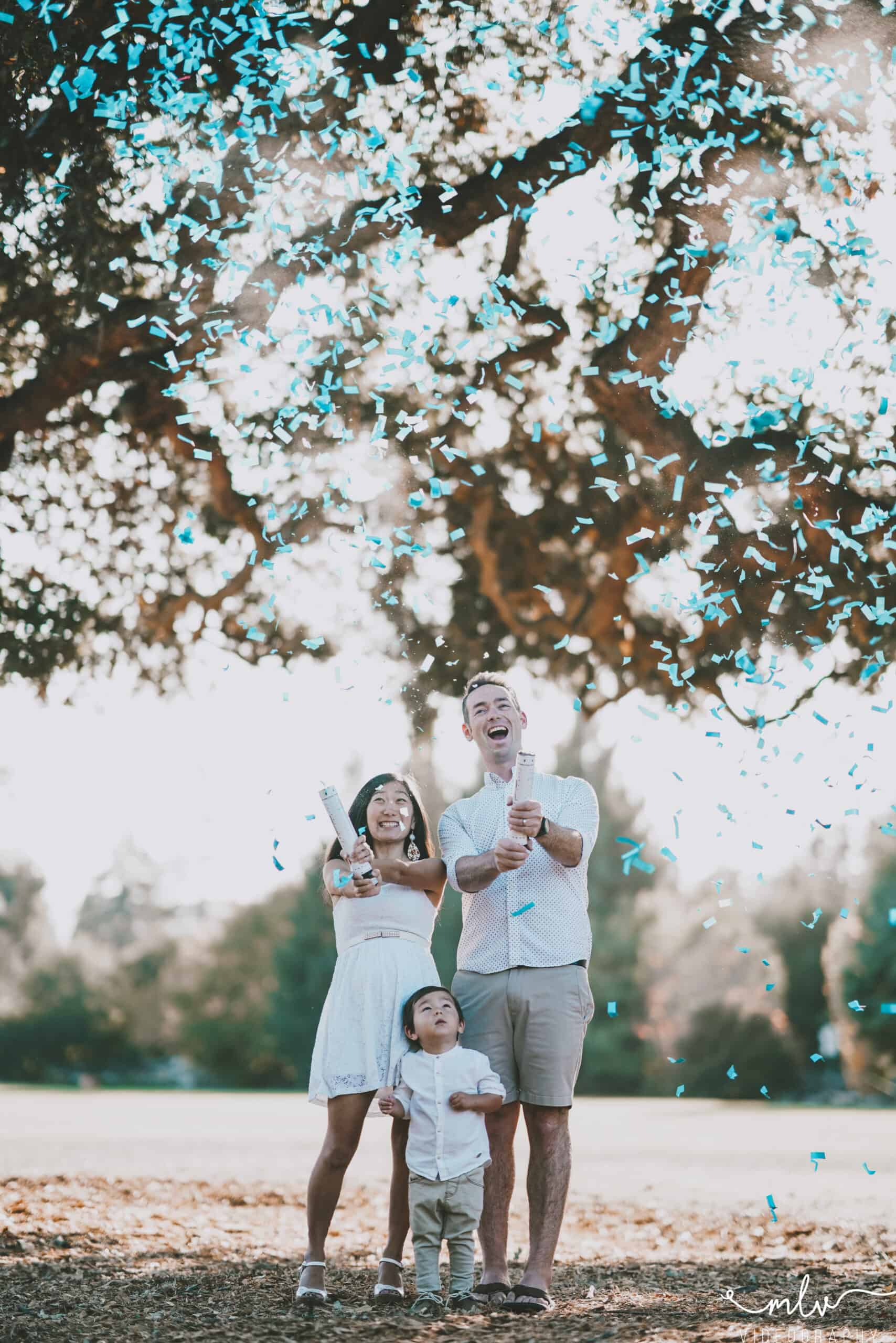 Bay Area gender reveal photography celebrating baby boy with confetti